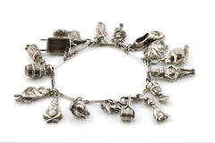 Vintage Charm Bracelet with 17 Silver Charms - Circa 1948