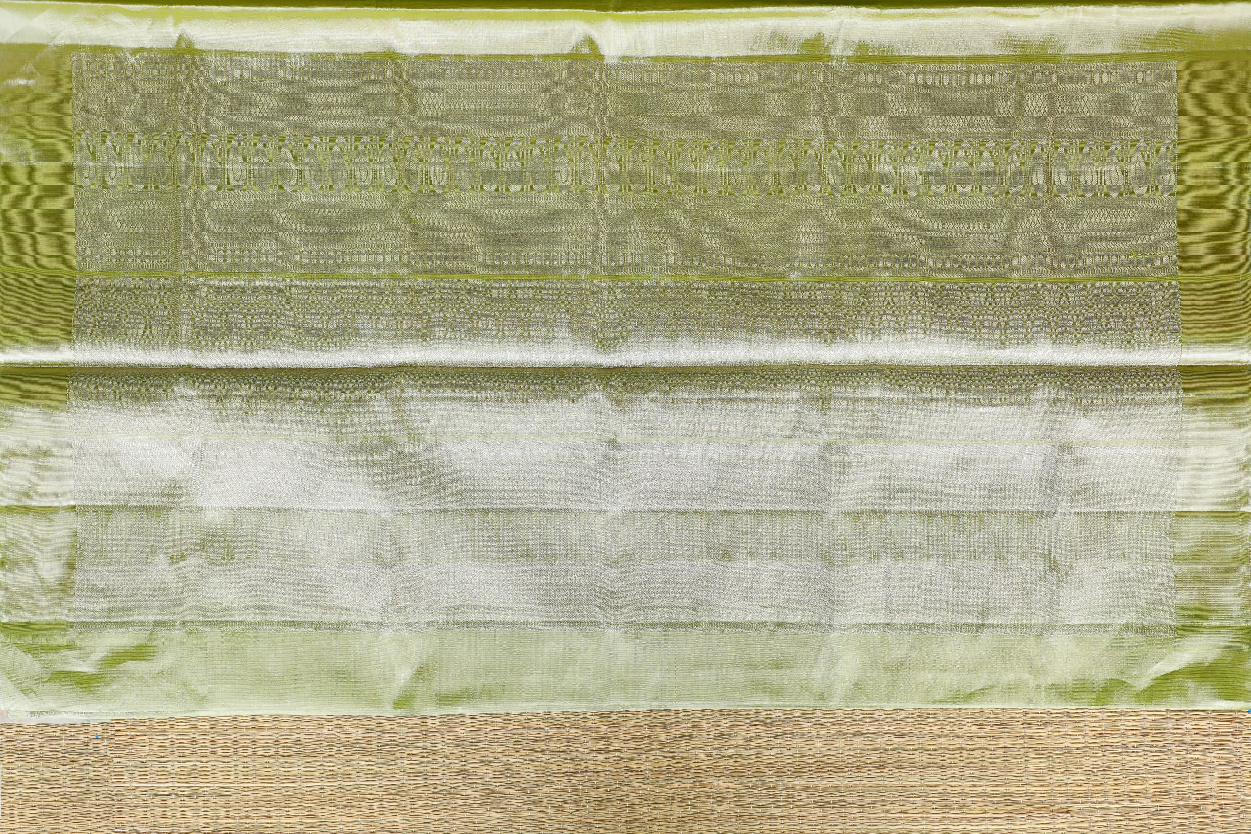Pastel green Tissue plain Kanchi Silk Saree with intricate pallu design SK262