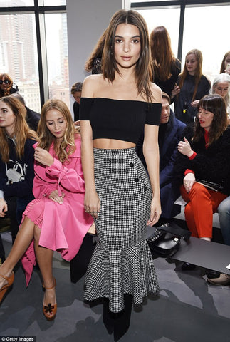 Braless Emily Ratajkowski shows off her perky assets and enviable abs in racy crop top with sexy secretary style skirt at Michael Kors NYFW show