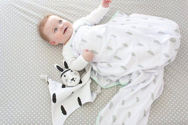 baby with kippin baby comforter