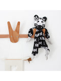 Kippins - Bam Kippin Zebra Baby Comforter Hanging on a hook