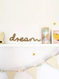 Glitter Dream sign on a shelf by Lala loves defor