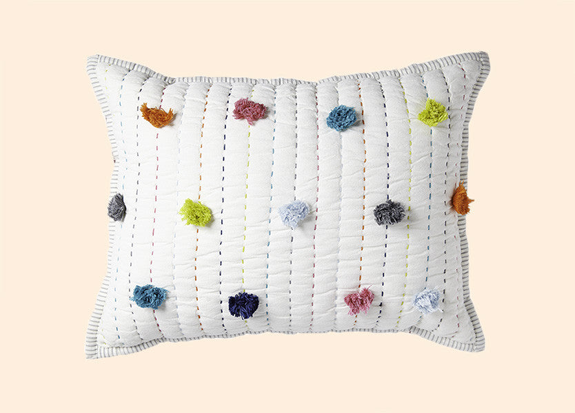 Pom Pom pillow for baby nursery