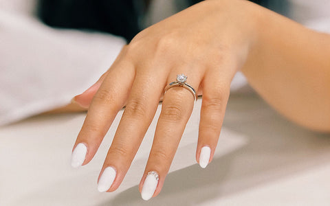 Woman's Manicured Hand With Engagement Ring