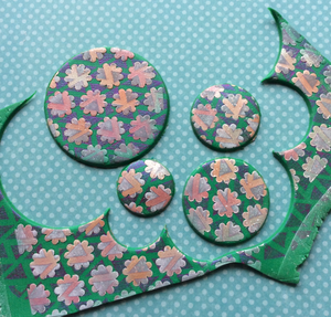 Create layered complex veneers on polymer clay using stencils, mica, and paint