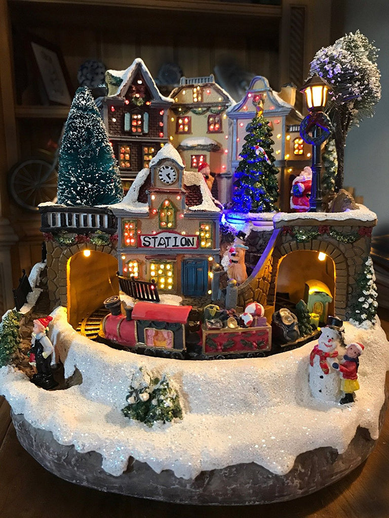 Gerson 10.2 in. Electric Fiber Optic Village with Moving Train and Music