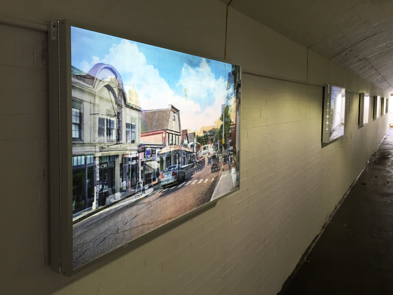 "DSA Standard Slim Line Light Boxes displaying Lenticular Art Installation in Westport, Connecticut train station, ""Picture Perfect: Westport Postcards Now and Then"", artist Miggs Burroughs"