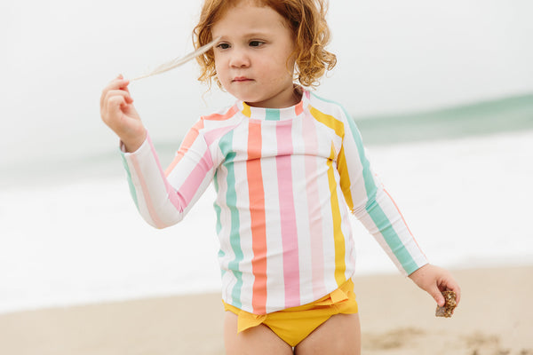 baby boy bakery Olivia and ocean swimsuit collaboration rainbow stripe rash guard