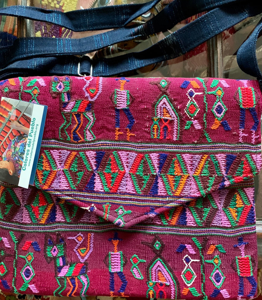Pouch made from hand-woven fabric with adjustable shoulder strap