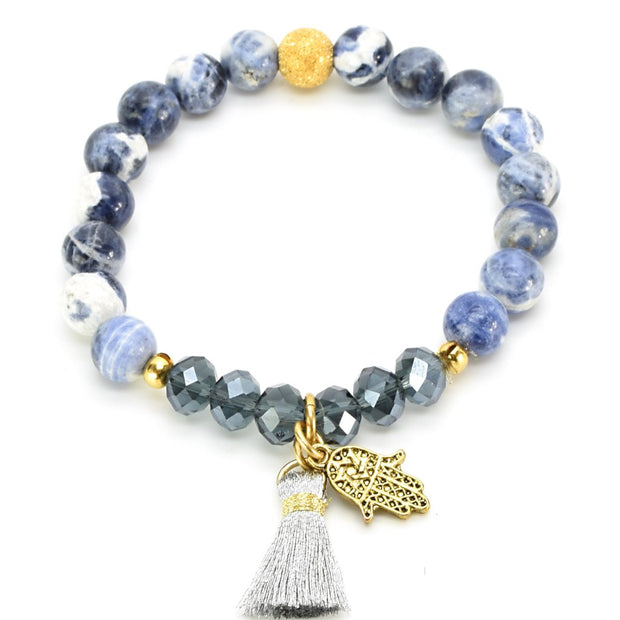 """CHARMED"" Hamsa and Tassel Denim Sodalite Stretch Bracelet"