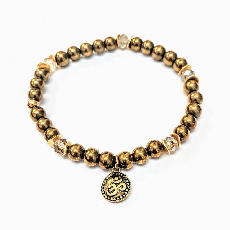 """MANTRA"" Golden Pearl and Crystal Om Charm Stretch Bracelet"