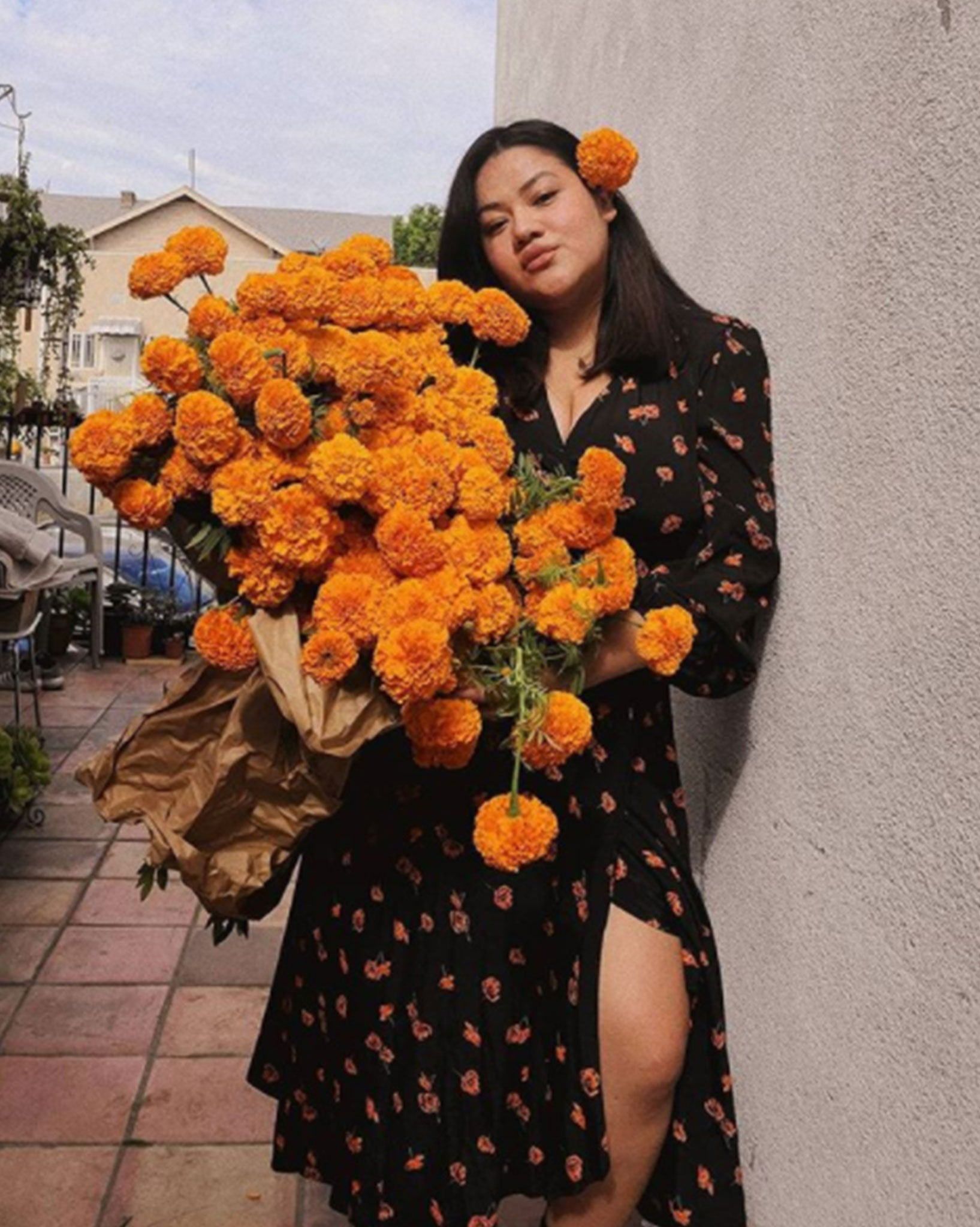 Valeria wears The Bergen Dress Extended in Persimmon Blossom