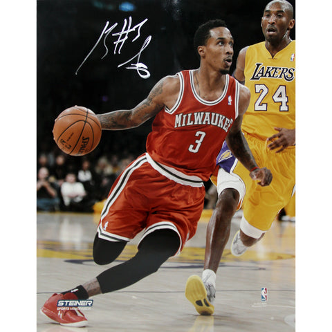 Brandon Jennings Drives Passed Kobe Bryant Signed 8x10 Photo(Getty 159553698) - Steiner Sports - Dropship Direct Wholesale