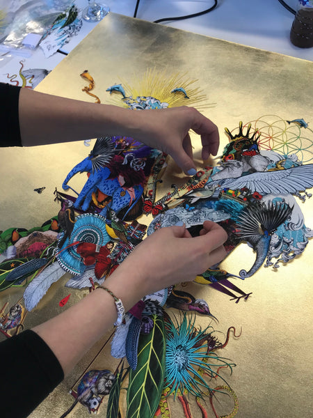 Kristjana S Williams works on the 3D collage that forms the blueprint for Coldplay's latest album A Head Full of Dreams: Live in Buenos Aires and Live in Sao Paulo