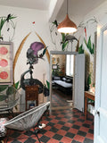 Giant ostrich and green plant wallpaper by artist Kristjana S Williams