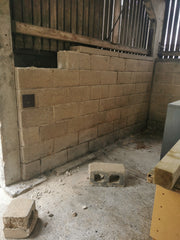 removing a concrete wall from the bullshed