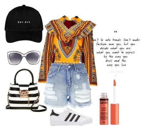 Yellow dashiki Victoria Top from A Leap of Style styled casually with distressed denim shorts, black and white striped bag, and adidas sneakers, boy bye hat