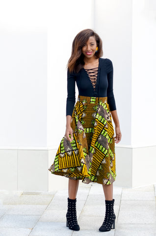 African print midi skirt in brown, black, yellow, and green with lace up bodysuit