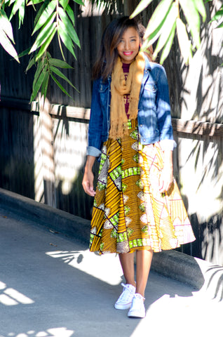African print midi skirt from A Leap of Style with vintage tee, scarf, denim jacket, and sneakers