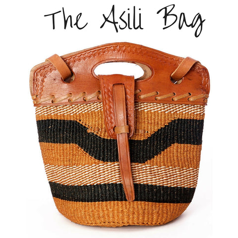 Handwoven brown, black, and tan sisal bag with leather strap and handles and tan leather top