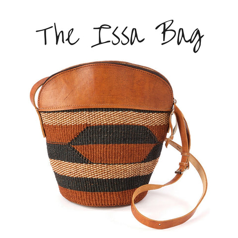 Handwoven brown, black, and tan sisal bag with long leather strap and tan leather top