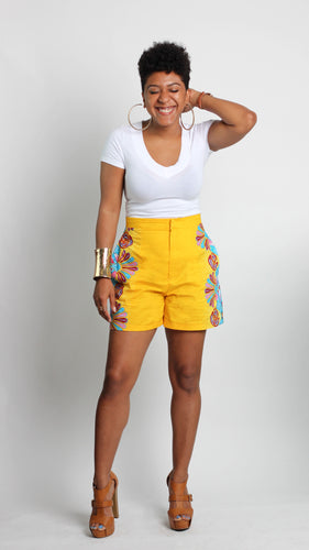 Yellow shorts with blue floral swirl print on sides front