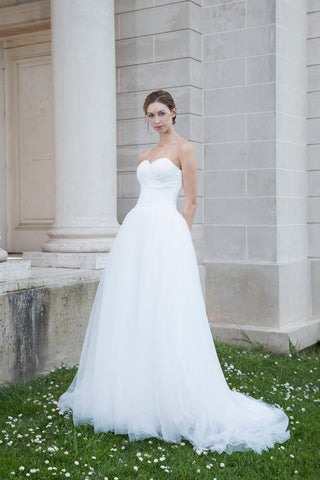Dora - Selena Huan clean-cut strapless natural flow tulle ball gown
