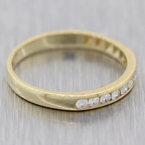 Modern 14k Yellow Gold 0.25ctw Diamond Channel Set Wedding Band Ring
