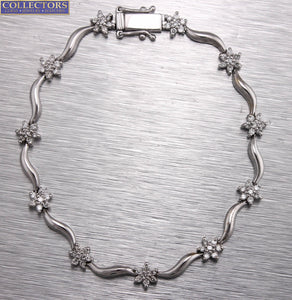 Ladies Estate 14K White Gold 0.77ctw Diamond Floral Cluster Tennis Link Bracelet