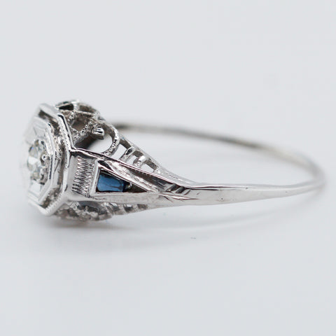 Ladies 1.4gram 14K White Gold .08 carat Diamond .04 carat Sapphire Cocktail Ring