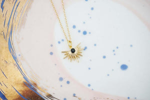 Gold Starburst and Black Gem Charm Necklace