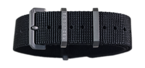 Ballistic nylon strap with exclusive etched titanium hardware, one piece failproof single piece buckle.