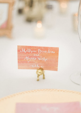 white calligraphy escort cards