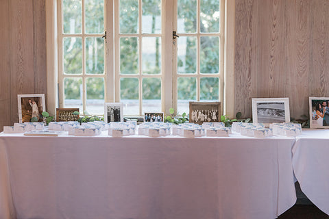 reception table with hydrangea escort cards