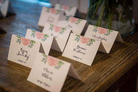 peony blueberry escort cards with hand calligraphy