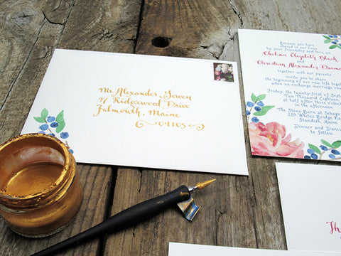gold calligraphy on wedding envelope