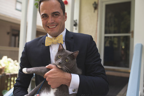 groom with pet cat