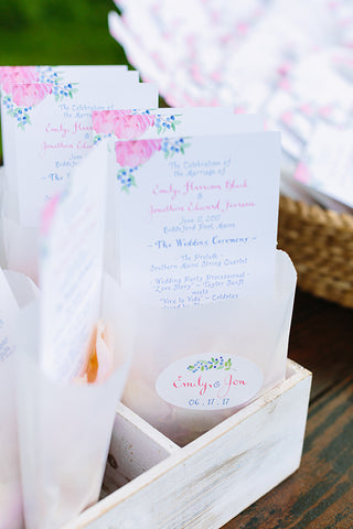 ceremony program with petals in bag