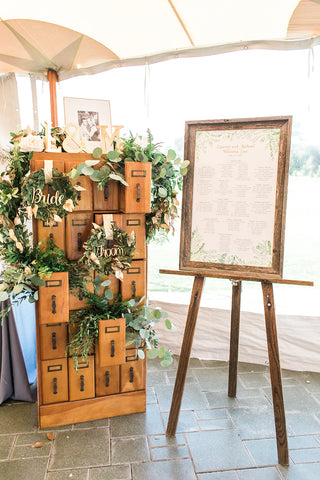 Seating chart display with greenery