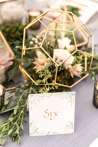 Table number with flourishing greenery in watercolor