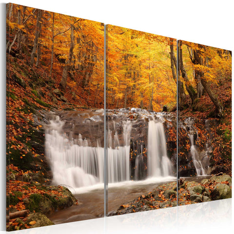 Canvas Print - A waterfall in the middle of fall trees