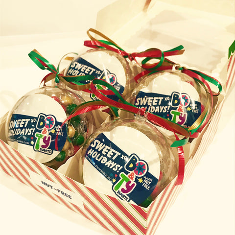 This holiday gift set for includes 4 Christmas ornaments filled with peanut free, tree nut free and gluten free chocolate candy.