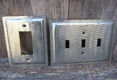 Plain baking pans custom made into a GFCI rocker cover and a triple switch plate.