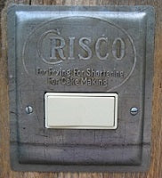 Vintage Crisco baking pan custom made into a horizontal rocker switch plate.
