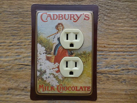 Outlet Cover Made From An Old Cadburys Chocolate Tin