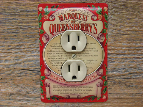 Outlet Cover Made From An Old Queensberrys Tea Tin
