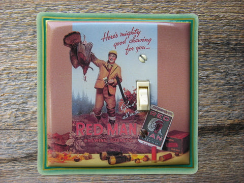 Light Switch Cover Made From An Old Red Man Tobacco Tin