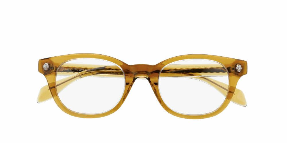 Angled View of Alexander McQueen Men's Eyeglasses - AM0027O-005 47 CRYSTAL TRANSPARENT HONEY YELLOW Acetate