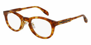 Front and Side View of Alexander McQueen Unisex Eyeglasses - AM0049O-003 49 SHINY COGNAC HAVANA SHINY ENDURA GOLD AVANA BROWN TRANSPARENT Acetate, Metal