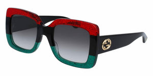 Angled View of Gucci Women's Sunglasses - GG0083S-001 55 SHINY GLITTER RED BLACK GLITTER EMERALD SHADED GREY CR 39 Acetate